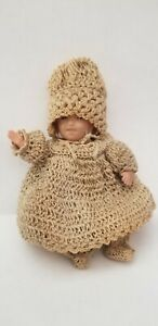 """ANTIQUE 5"""" CELLULOID JOINTED DOLLHOUSE DOLL W/ ANTIQUE CROCHET LAYETTE OUTFIT"""