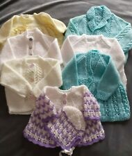 Hand knitted baby cardigans, coats and dress.  New.