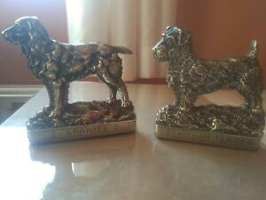 Brass dog animal bookends .
