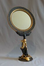 Antique bronze and ormolu mirror with octopus and boy on dolphin.