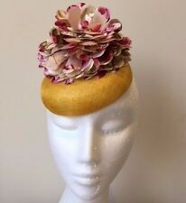 Yellow button base fascinator with a multi coloured flower!