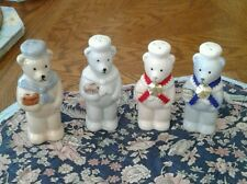 SET OF FOUR CONDIMENT SHAKERS