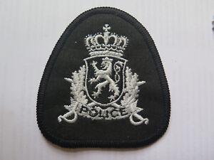 POLICE CLOTH BADGE c1990s with STANDING LION CREST BELOW QUEENS CROWN