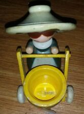 VINTAGE FIGURE  LADY PUSHING A CART MADE OF WOOD GREEN YELLOW HAT
