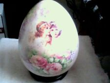 """Ceramic egg shaped Angels Floral on wood stand 8"""" tall x 6"""" diam max"""