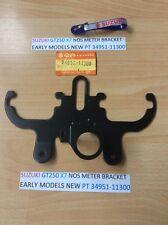 SUZUKI GT250 (X7) NOS METER BRACKET NEW WITH PARTS TAG PT NO 34951-11300