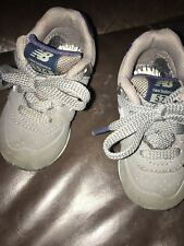 Gray and Blue New Balance Size 4c