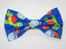(1) PRE-TIED BOW TIE - COLORFUL BABY SEA TURTLES TOSSED ON ROYAL BLUE