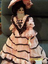 Coca  Cola Lady dressed in pink and black  Franklin Heirloom Doll porcelain doll