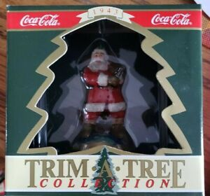 coke cola cola 1943 santa standing on top of the world with toy bag