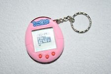 tamagotchi connection  pink with red buttons  2004