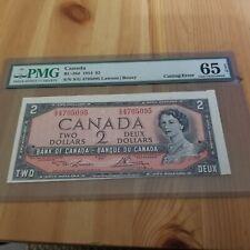 1954 Bank Of Canada 2 Dollar *Cutting Error rare* PMG: 65 Gem Uncirulated RARE.