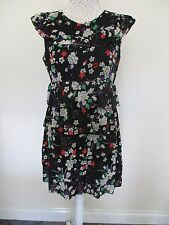 Top Shop tiered ruffle dress. Party. Fully lined worn once. Black with floral.
