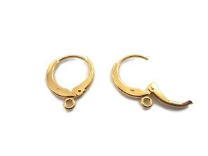 1 paio di monachelle tonde con chiusura in argento 925 placcato oro giallo