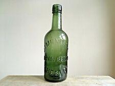 More details for vintage green embossed j.t. milne & son - tarvin bridge chester glass bottle