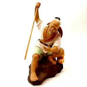 Chinese Mudman Figurine Figure Crouched on Rock w/ Jar Holding Wood Stick