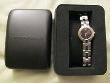 Emporio Armani ladies chrome watch with black dial.  Comes with case and box.