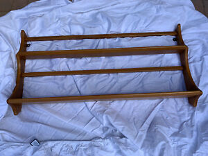 Ercol plate rack. Light Elm colour for wall mounting. Good condition.