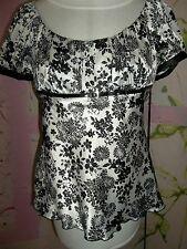 """STUDIO Y"" Boat neck blouse with floral pattern, belted at waist. Size Medium"