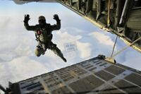US Navy USN Seal freefalls from an Austrian C-130 aircraft ST 8X12 PHOTOGRAPH