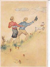 Couple walking in a field Unknown Postcard Unused VGC