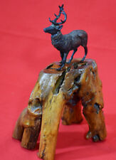 Figure in bronze of a deer with a wooden stand #2506
