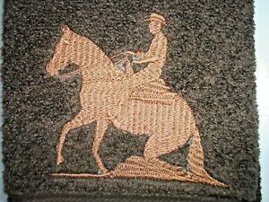 REINING HORSE, EMBROIDERED DESIGN, ON A DARK BROWN HAND TOWEL