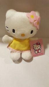 Sanrio - Plüschfigur Hello Kitty mit gelbem Kleid 15cm Neu mit Etikett
