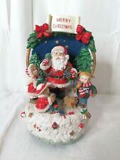 Jolly Santa musicale Parures 16 cm x 13 cm on vous souhaite un joyeux Noël