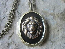 BRONZE LION LOCKET ON BLACK BACKGROUND - AFRICA, LION HEAD, SAFARI