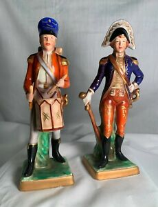 """Vintage Soldier Figurines, 2 different, 7"""" tall, blue """"Crown over N"""" imprint"""