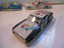 voiture en tole made in japan 50/60 a friction police