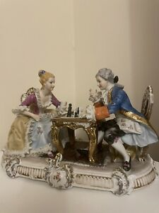 ANTIQUE GERMAN PORCELAIN FIGURINES MAN AND WOMAN PLAYING CHESS