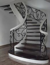 Wooden staircase Oak wood curved stringers wrought iron balustrade from Poland