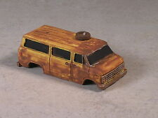 HO 1976 Yellow Rusted out Chevy Van with tire on roof..