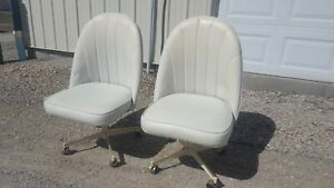 Two Vintage Mid Century White Vinyl Leather Rolling Swivel Dining Chairs