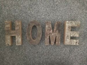 Rustic Bark Letters spelling HOME with wall hanging hooks