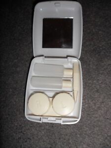 white plastic contact lens case with accessories