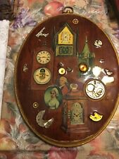 collage of watch parts wall plaque, original one of a kind. Oval shape