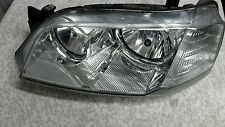 TERRITORY FORD LH CHROME HEAD LIGHT.SX/SY. BUILT 6/2004 TO 4/2009