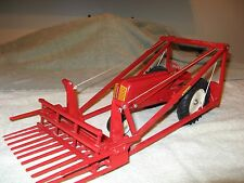 Farmhand loader on toy Cockshutt 70 tractor