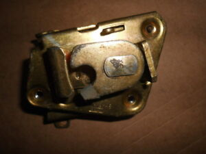 FORD  DOOR LOCK CATCH 76AB F26412-AB NEW OLD STOCK