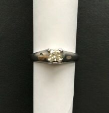 18ct white gold solitaire diamond ring.A square stone weighing 0.33ct claw set .