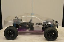Hpi Mt2 18Ss Roller with body, motor mounts, and non pull start flywheel.