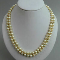 A FINE CULTURED PEARL DOUBLE STRAND NECKLACE WITH A 9 CT GOLD CLASP - 41.6 GRAMS