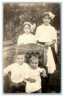 Portrait 2 Girls, Young Boy,& Toddler  RPPC Real Photo Postcard Divided Back