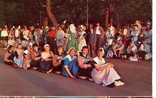HOLLAND,MICHIGAN-DUTCH DANCERS SIT ON THE SHOES OF THE ONE IN BACK--(MICH-H)
