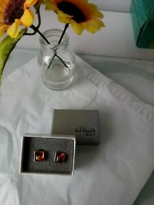 Kit Heath silver earrings mounted with Amber
