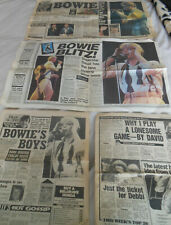 David Bowie newspaper pull outs and cuttings .