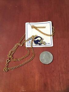 Minnesota Vikings Helmet Team Logo Pendant With Gold tone necklace.